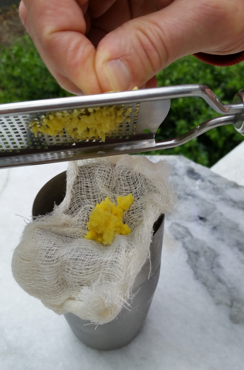 Grate ginger onto cheesecloth. Photo by Susan Whitney.